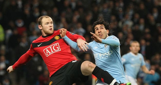 Rivalries renewed: Rooney and Tevez tussle in 2010. Who will come out on top this time?