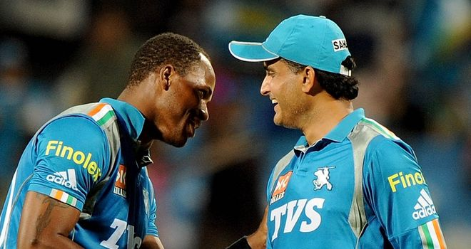 Marlon Samuels (left) and Sourav Ganguly: Pune Warriors skipper defended his bowler