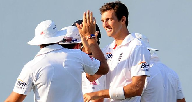 Steven Finn: Celebrates with England team-mates after taking his wicket on day one
