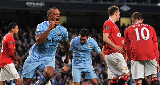 Vincent Kompany: Celebrates the winning goal in the Manchester derby