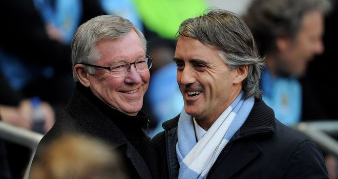 The Manchester managers Sir Alex Ferguson and Roberto Mancini set for battle at Old Trafford