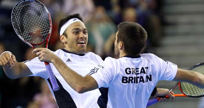 Colin Fleming and Ross Hutchins celebrate with a chest bump after four-set victory