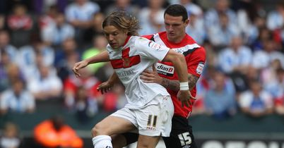 Tense: Alan Smith holds off Sean Morrison