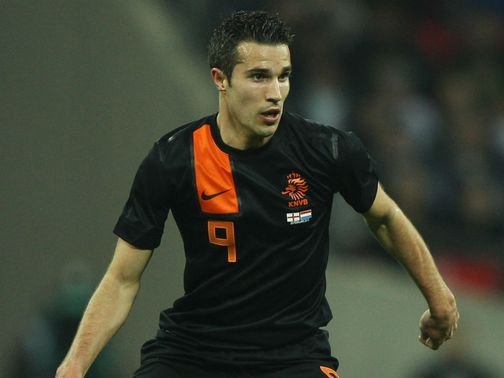 Van Persie: Tipped to stay with the Gunners