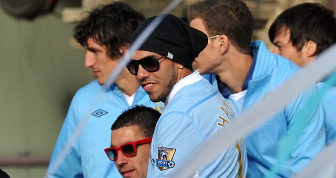 Carlos Tevez: On bus during Manchester City's celebrations