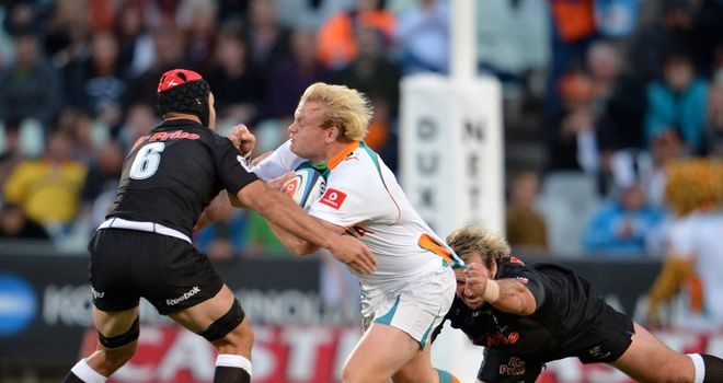 Cheetahs' Adrian Strauss is brought to a halt in Bloemfontain
