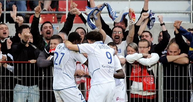 Delvin Ndinga: Auxerre midfielder is mobbed after scoring the second goal against Dijon