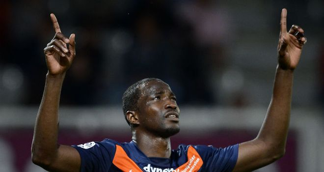 Title clincher: John Utaka celebrates scoring for Montpellier against Auxerre
