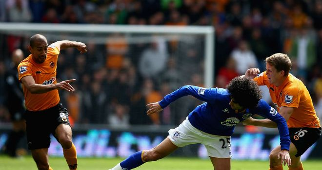 Marouane Fellaini battles forward for Everton