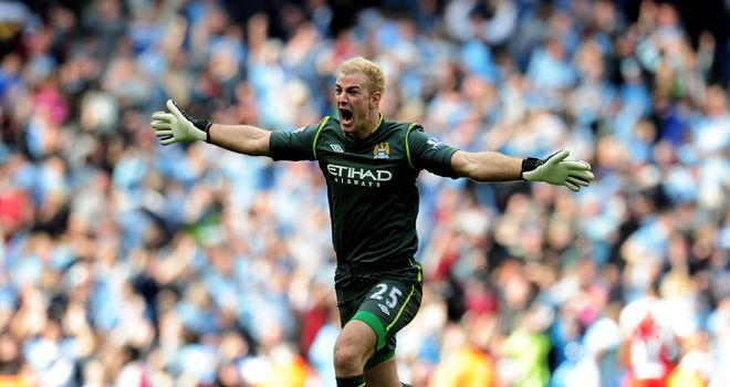 Joe Hart celebrates Sergio Aguero's dramatic winner against QPR
