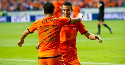 Afellay: Celebrates with fellow scorer Van Persie