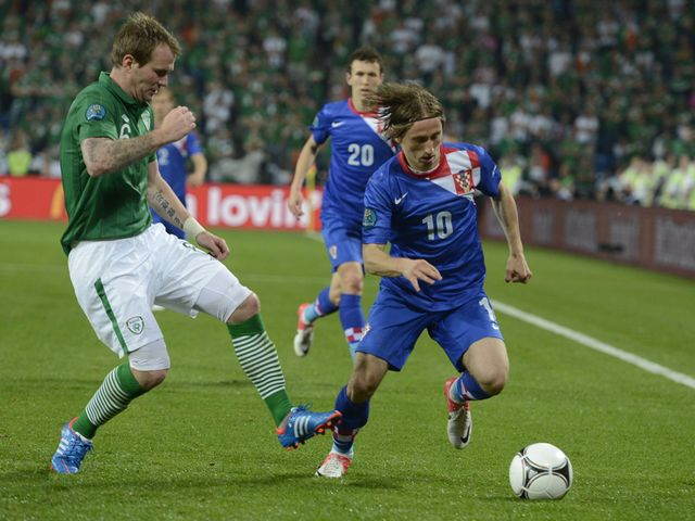 Modric uses his skill to get past Whelan