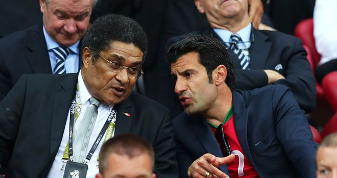 Eusebio alongside fellow Portugal hero Luis Figo before falling unwell at the weekend