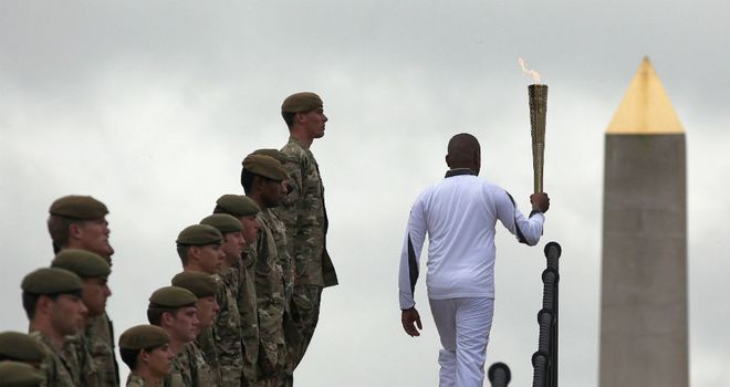 War hero Johnson Beharry with the Olympic Torch