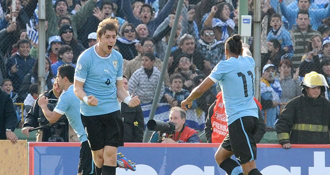 Sebastian Coates: The defender celebrates the Uruguayans opening goal