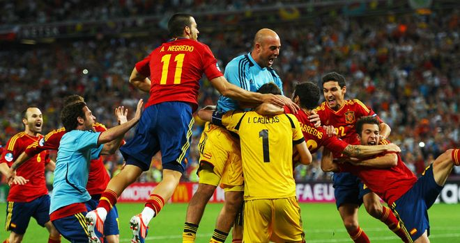Cesc Fabregas: Mobbed by his team-mates after scoring the winner
