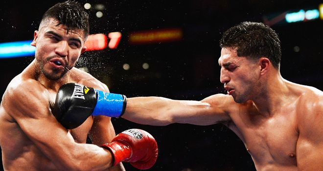 Big break: Lopez, right, broke Ortiz's jaw - but could he not have fought on?