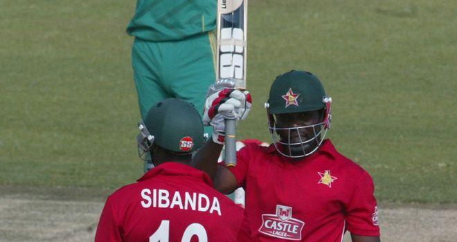 Vusi Sibanda helps Hamilton Masakadza celebrate his half-century