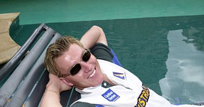 Relaxing: Brett Lee takes it easy by the pool in Brisbane in November 2000