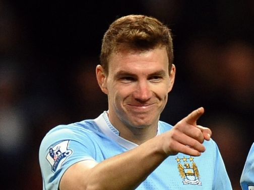 Edin Dzeko: Striker is 'pretty unlikely' to leave Man City
