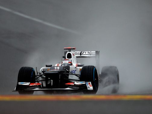 Kamui Kobayashi braves the weather at Spa