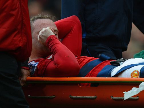 Rooney had to be stretchered off after his thigh was cut