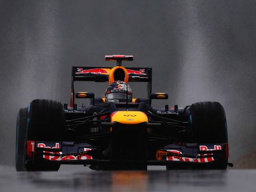 Sebastian Vettel drives in the rain at Spa