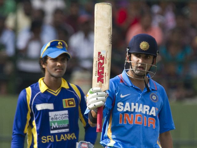 Gautam Gambhir salutes the crowd after reaching 50
