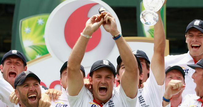 Andrew Strauss gets his hands on the little urn in Sydney