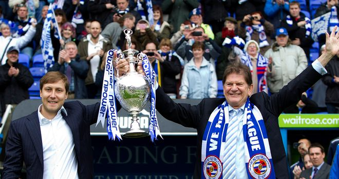 Anton Zingarevich and Sir John Madejski lift the 2011/12 Championship trophy