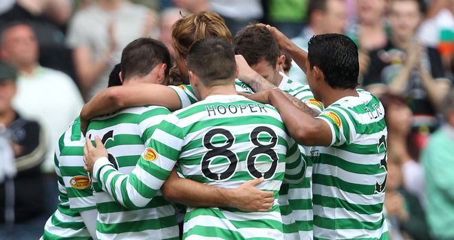 Celtic players celebrate their 1-0 win over Aberdeen