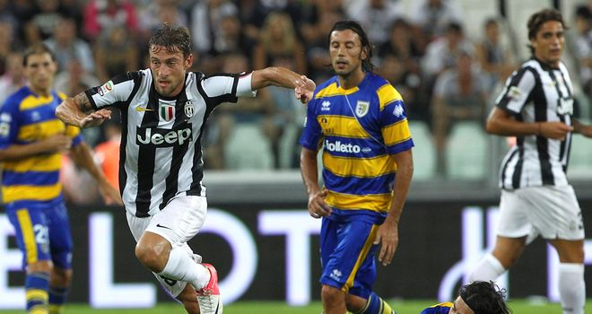 Claudio Marchisio shakes off a challenge