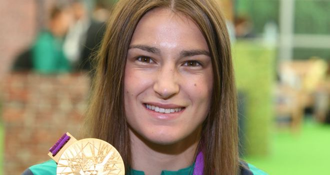 Katie Taylor: Poses with her gold medal as she prepares to fly back to Ireland