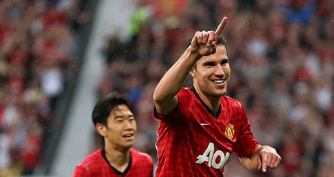 Robin van Persie and Shinji Kagawa celebrate during Manchester United's 3-2 win over Fulham