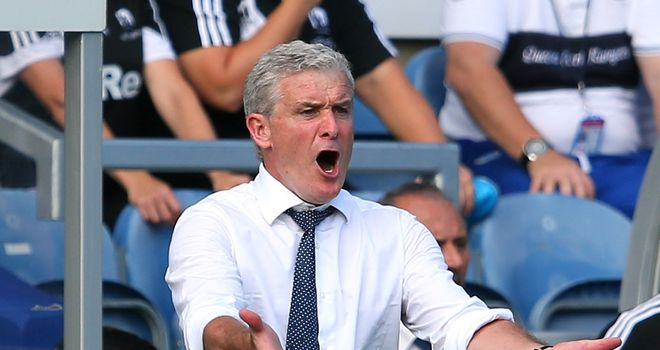 Mark Hughes: QPR manager dejected with his side's performance against Swansea City