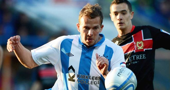 Rhodes: Set for Rovers debut