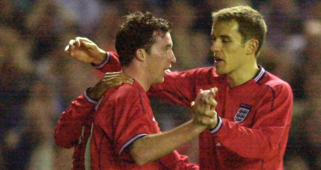 Robbie Fowler enjoys a rare outing in an England shirt