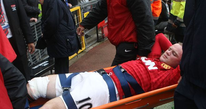 Wayne Rooney: Manchester United striker likely to be out for four weeks after suffering leg injury