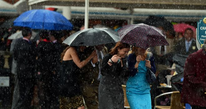 Racegoers battle the elements