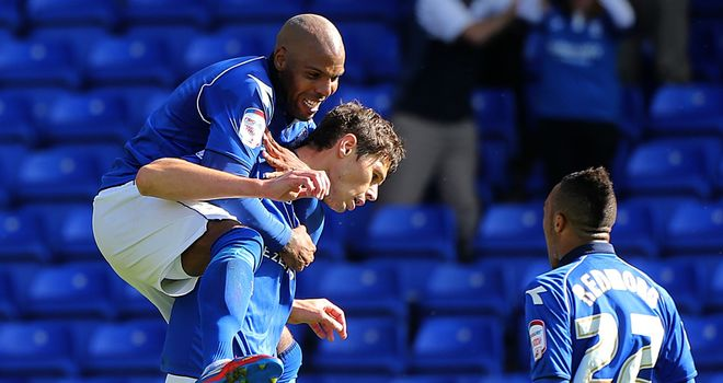 Zigic: Celebrates his dramatic equaliser