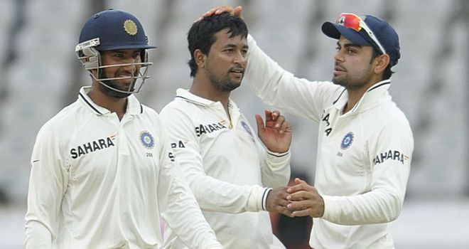 Pragyan Ojha (centre) will be a key threat to England in this series
