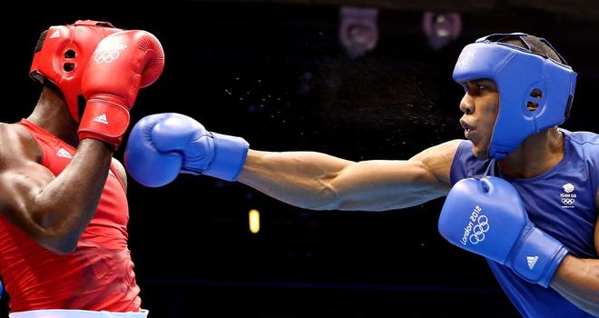 Narrow victory: Joshua (R) edged past Cuba's Erislandy Savon at the ExCel