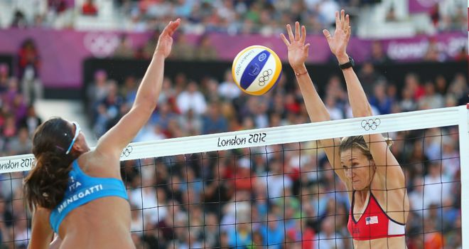 Kerri Walsh (right) rises high to block Marta Menegatti