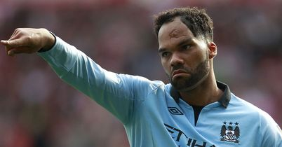 Joleon Lescott: Happy to stay at Manchester City and fight for his place