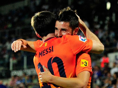 Messi and Villa celebrate for Barcelona