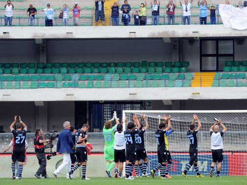 Lazio players applaud their travelling support