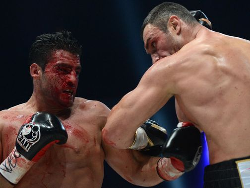 Manuel Charr (l) was left bloodied and beaten by Klitschko