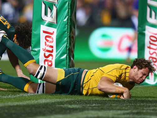 Scott Higginbotham scores an Australia try