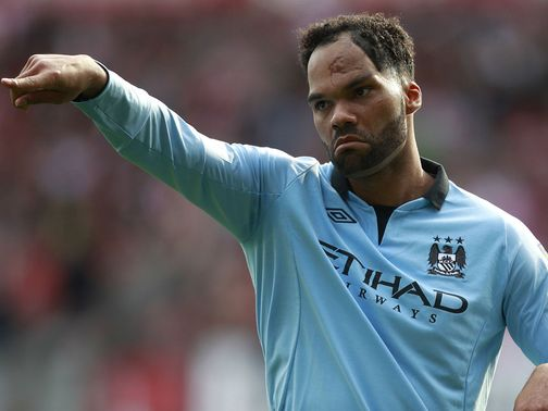 Joleon Lescott: Happy to stay at Manchester City