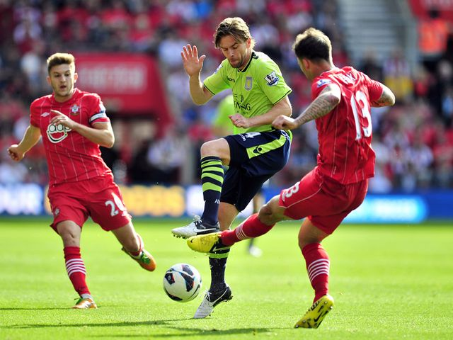 Brett Holman goes in for a tackle on Danny Fox